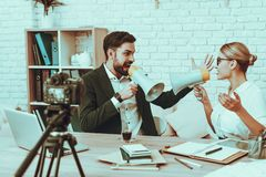 Bloggers makes a video about a business royalty free stock photography