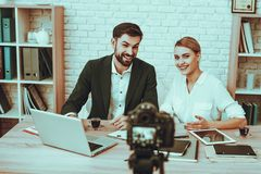 Bloggers makes a video about a business stock photography
