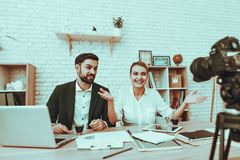 Bloggers makes a video about a business royalty free stock image