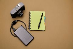 Blogging, blog and blogger or social media concept: notepad, retro photo camera and external hard drive on the background. Flat. Lay royalty free stock photo