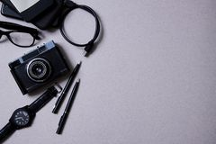 Blogging, blog and blogger or social media concept: retro photo camera and accessories for bloger. Flat lay.  stock photo