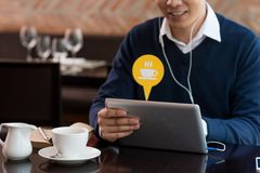 Blogging in cafe Stock Image