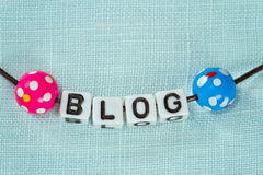 Blogging concept - letters on blue fabric Royalty Free Stock Photography