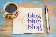 Blogging concept on a napkin. Blog, blog, blog - blogging concept on a napkin with cup of espresso coffee royalty free stock image