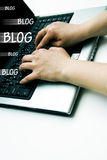 Blogging on laptop Stock Photo