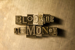 Blogging for money - letterpress text sign. Lead metal  typography text on wooden background Royalty Free Stock Photography