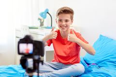 Happy boy with camera recording video at home Royalty Free Stock Photography