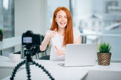 Blogging, technology, videoblog, mass media and people concept. Happy smiling woman or blogger with camera recording video and showing thumbs up at home royalty free stock photos