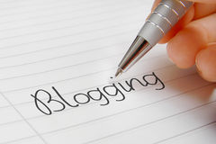 Blogging word handwriting. Blogging word concept background on paper Stock Image