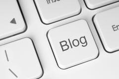 Blogknapp på tangentbordet Arkivbild