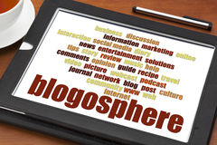 Blogosphere word cloud on digital tablet royalty free stock photography