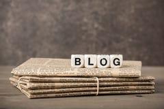 Blogwort und -zeitungen Stockfoto