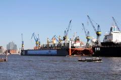Blohm+Voss Shipyard with floating dock 10. HAMBURG, GERMANY - MAY 5, 2018: Blohm+Voss Shipyard with floating dock 10 and Elbe Philharmonic Hall Elbphilharmonie royalty free stock images