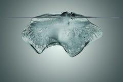 Blok lód z podwodnym widokiem z ścinek ścieżką Zdjęcia Royalty Free
