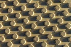 Blok van de textuur het gele barrière als achtergrond stock afbeelding