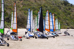 Blokarts waiting to race. Land sailing yachts parked between races line up of land sailing yachts waiting between races on the beach in Queensland, Australia Royalty Free Stock Photos