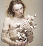Bloke. Daydreaming Young Man holding Bouquet of Flowers. Cotton Royalty Free Stock Photos