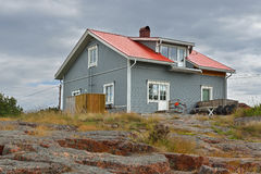 Blokhuis op rotsen Stock Foto