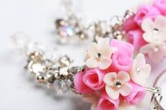 Blom- örhängen Fotografering för Bildbyråer