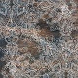 Blom- östlig prydnad - blommor, paisley på gammal wood textur Arkivfoton