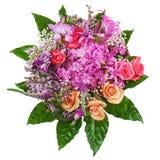 Blom- bukett av rosor, liljor och orkidér på vita lodisar Arkivbild