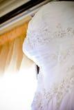 Blom- detalj för bröllopsklänning Royaltyfria Bilder