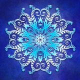 Blom- mandala på grungeblåttbakgrund Arkivbilder