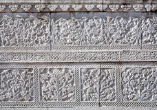 Blom- modeller på textur av den forntida templet Arkivfoton