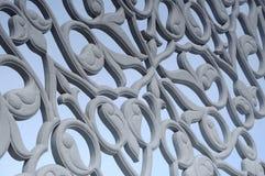Blom- motiv som snider modellen som göras från GRC på byggnadsyttersida Royaltyfri Fotografi