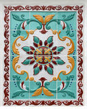 Blom- prydnad på tegelplattor royaltyfria bilder