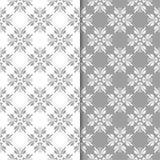 Blom- prydnader för vit och för grå färger seamless set för bakgrunder