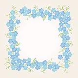 Blom- tappningram med förgätmigejblommor Arkivfoto