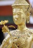 blommaguldskulptur Arkivbild