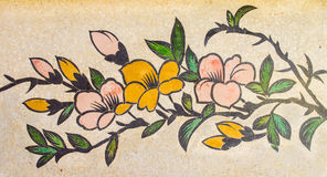 Blommamålning på granitväggen Royaltyfria Bilder
