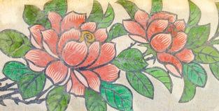 Blommamålning på granitväggen Arkivbild