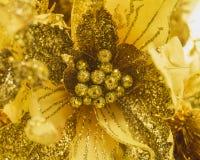 Blomman med guld blänker för garnering arkivbild