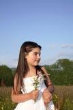blommar flickabarn Arkivfoto