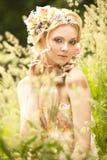 blommar flickahår henne som är ung Arkivbild