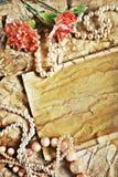 blommar gammala papperen för halsbandet Fotografering för Bildbyråer