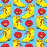 Blommar gulnar den sömlösa modellen för vektorn med röda tulpan och gummistöveln med pilbågen på den blåa bakgrunden vektor för d Fotografering för Bildbyråer