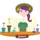 blommor arbeta i trädgården fjäderkvinnan Arkivbild