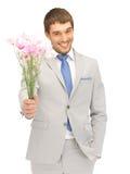 blommor hand den stiliga mannen royaltyfri foto