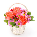 Blommor i korg Arkivbild