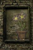 Blommor i tegelstenväggen Royaltyfri Bild