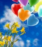 blommor och festliga ballonger mot himmelnärbilden royaltyfria bilder