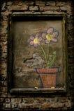 Blommor som drar på en tegelstenvägg Royaltyfria Bilder