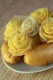 Blommor som göras från en potatis Arkivfoto