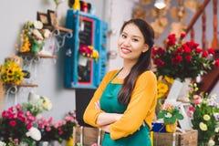 Blomsterhandelägare royaltyfri foto