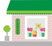 blomsterhandlaren shoppar fönstret Royaltyfri Foto