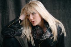 Blond. Young woman portrait in dark Royalty Free Stock Image